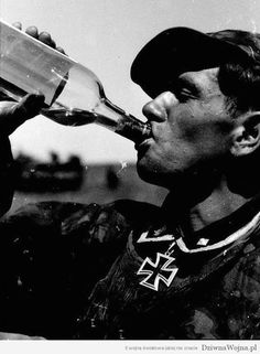 Waffen SS man, just decorated with the Knights Cross, takes a swig in celebration of the occasion. Proportionally speaking, the Waffen SS claimed significantly more battle decorations than the regular army.