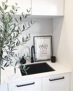 LAUNDRY - WHITE PENNY SPLASH BACK, BLACK SINK AND TAPS AND WHITE CUPBOARDS