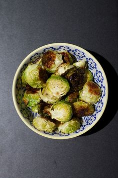 Roasted Brussel Sprouts 1) Rinse as many brussel sprouts as you want. Cut off the end and slice in half. 2) Peel off the outer layer of the sprouts and lay leaf-side down on a baking sheet. 3) Drizzle with coconut oil and then sprinkle with sea salt and pepper. 4) Bake for 15 minutes at 350ºF. Let cool for a minute or two before you dig in, because they will be hot!