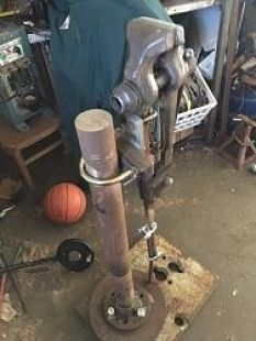 Post Vise Stand - Homemade post vise stand constructed from a surplus axle, brake disk, and tractor weight.
