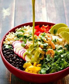 This Chopped Salad Recipe is filled with all good things and packed with flavor! Topped with Cumin Lime Shrimp and tossed with a Cilantro Lime Dressing that is light and flavorful but can be made spicy with a little jalapeno. A delicious way to eat healthy!