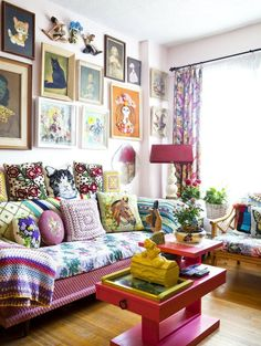 John Webster interior with ecclectic retro furnishings including cat portraits and crochet pillows