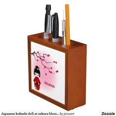 Japanese kokeshi doll at sakura blossoms pencil holder