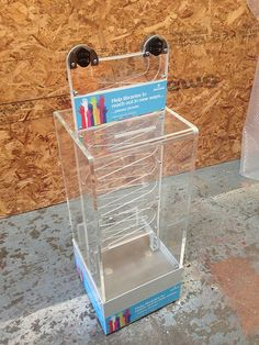 Coin Ramp Interactive Donation Box.  I like this one because it looks like it also has a slot for bills!