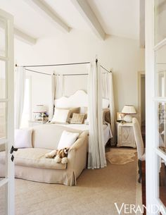 Piero Castellini Baldissera   Neutral tones and a romantic canopy make for an ethereal guest room.