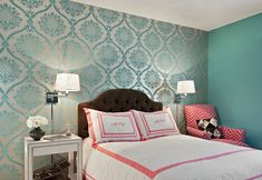 Gorgeous girl's room features accent wall clad in teal damask wallpaper and the rest of the walls painted teal.