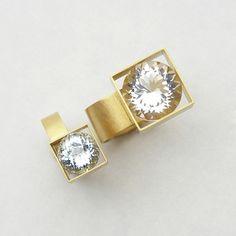 Rings |  Herman Hermsen.  Gold  + aquamarine (smaller image) AND Gold + rockcrystal (larger image)
