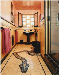 mosaic snake inlaid into 1920s tile floor.