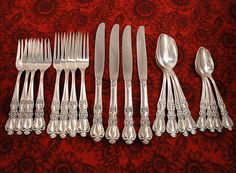 Up to a service for 16 available in this International Silver 1847 Rogers Bros. HERITAGE silverplate flatware set. This elegant pattern dates back to 1953. The handles feature a classical violin shape edged with feathery scrolls, highly detailed flowers and a fan shaped tip. There is up to a complete service for 16 available but we are offering the sets in services of 4, so you can choose if you would like settings for 4, 8, 12 or 16 people. Just pick the quantity desired. Price listed is…
