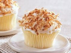 Love coconut? Cupcakes with a triple blast of coconut bring you to the tropics.
