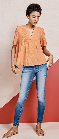 A billowy pintuck top paired with super skinny (and super flattering) Rockstar jeans for an outfit that'll last ya all day...and night. For a late night look, slip into a pair of stacked sandals and add a few gold bangles for a chic ensemble. 1d