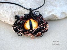 Gold coloured Dragon's Eye wire wrapped pendant by IanirasArtifacts.deviantart.com on @DeviantArt