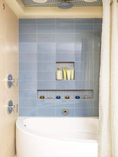 Bathroom Space-Savers With space at a premium, there wasn't room for separate tub and shower units. The compact soaking tub has a graceful curve that doesn't impose on the limited floor space. Shower in the ceiling. Corner Tub Shower Combo, Corner Bathtub Shower, Shower Tub, Bathtub Tray, Rain Shower, Small Bathroom Storage, Shower Storage, Shower Units, Beautiful Bathrooms