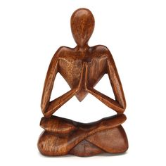 """BERSE MEDITATING WOOD CARVING Handcarved from sustainable rain tree wood, this sculpture sits 8"""" high. Handmade by talented artisans in developing countries. Imported."""