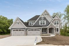 James Hardie Night Gray Siding & Shakes with Pearl Gray Accent on Board & Batten, Lap Siding in Peaks & Garage Doors. Grey Exterior, Modern Farmhouse Exterior, House Paint Exterior, Dream House Exterior, Exterior House Colors, House Exteriors, Exterior Design, Hardie Board Siding, Gray Siding