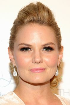 Jennifer Morrison with false lashes, dewy skin, and pink lips