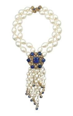 Gripoix for Chanel Faux Baroque Pearl Necklace French, 1984 Double stranded large beads with gilt-metal filigree hexagonal pendant inset with blue pate de verre stones and rhinestones, each strand of smaller pearl tassel culminating in gilt-metal and blue bead drop, 17 inches, marked: Chanel/1984. Excellent condition. Sold for $960 (2005)