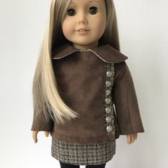 This is a reserved listing for customer MM. Your doll will be dressed in style in this trendy quilted jacket made from a chocolate 100% cotton micro wale corduroy. The jacket is fully lined in 100% cotton tan plaid with the sleeves lined in ivory satin fabric for easy dressing. This adorable coat features hand embroidered feather stitch detail on the underside of the collar, working metal buttons down a front wool placket with tan anchor buttons inside and a seventeen piece diagonal quilt…