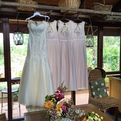 Lovely way to display the dresses from the old farm ladder