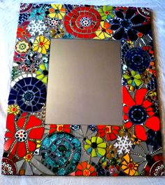 striking mosaic mirror on European shop site. Lovely eye candy for most of us. Inspiration for some and an heirloom piece for someone lucky enough to buy it. Mirror Mosaic, Mosaic Wall, Mosaic Glass, Mosaic Tiles, Mosaics, Tiling, Mosaic Madness, Mosaic Crafts, Mosaic Projects
