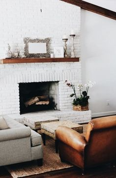 cozy family room design with leather chair and white brick fireplace