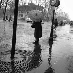 by Adolfo Kaminsky The rain, Woman with umbrella. Paris, 1949