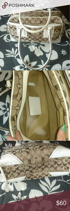 Real tan and cream Coach purse Very good condition coach pocketbook. Cream and tan colored with gold accents. Coach Bags