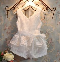Let us have tea! Your little one will be the talk of the party in this two piece shorts and top.