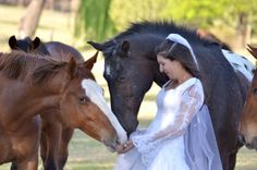 Love the bride with all the horses!