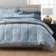 Adriana 400-Thread Count Sateen Comforter Collection - Replicating the weathered patina of a vintage textile, this beautiful comforter displays grand-scale blooms drifting across a textural ground in faded hues of chambray, white and indigo.