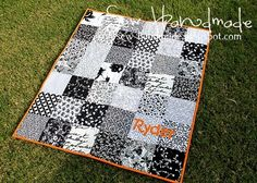 black and white and orange baby quilt, monogramed. I'd like to make this with red instead of orange (wps!)