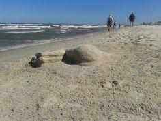 Sand sculpture. Dębki beach. Poland.  Woman....