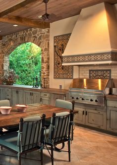 exterior kitchen and living space - custom clay tiles with inlay colors - KJP available at ADR