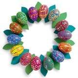 Image only - decorate plastic eggs with paint pens , hot glue to cardboard wreath.