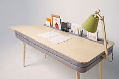 The Oxymoron Desk. A Comfortable Work Desk That Holds Everything. This work table includes a lamp and a side desk. Both can be inserted from different sides and positions, what gives freedeom to the user.  desk is a result of interaction between two contradictionary materials that enhance each other and gain a new meaning. Two layers of foam with an alcantara cloth are placed between plywood sheets to form a toolbax to store documents, objects and technical devices…