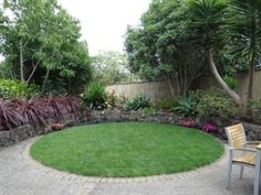 Subtropical small suburban garden with lawn www.cwlandscapes.co.nz