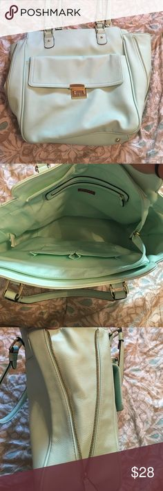 Merona mint zipper side tote Pretty mint purse with many pockets! Sides can be zipped up for a structured square bag or unzipped for more space and a flared look! Merona Bags Totes