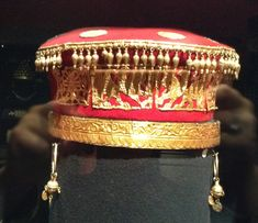 Beautiful and ornate Scythian women's headdress and earrings. The headdress is a reconstruction, and the earrings are archaeological artefacts. The 5th century B.C.