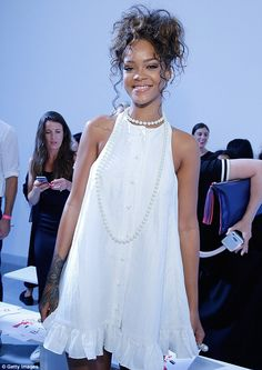 Model smile: Rihanna were perfectly coiffed and made-up as she continued to smile for the camera
