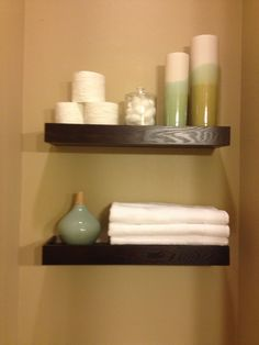 floating shelves above toilet - downstairs bath