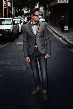 Grey woollen blazer with black piping detail, grey gingham shirt, Ralph Lauren Rugby bow tie, red and white polka dot pocket square, grey Levis 501 jeans, brown suede derby shoes, red laces