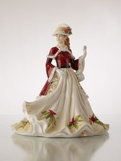 This beautiful fine bone china figurine is the epitome of Christmas Cheer. Dressed in an elegant cream gown and striking red coat, she is bringing warm wishes to all.