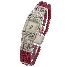 Hamilton Lady's Platinum, Diamond and Ruby Bracelet Watch on Ruby Beads. Finely made Deco watch featuring a geometric filigree design with diamonds and channel set rubies. A contemporary ruby bead band with diamond spacers and a new clasp has been added t Bijoux Art Deco, Art Deco Jewelry, Fine Jewelry, Jewelry Design, Jewellery, Beaded Jewelry, Ruby Bracelet, Bracelet Watch, Bracelets