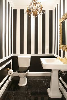 Beautiful Bathroom Color Schemes You'll Love : Luxury Black and White Bathroom with White Pedestal Sink and Fancy Gold Chandelier also Carving Gold Frammed Mirror and Black White Striped Wall Painting and Black Marble Ceramic Tile Flooring Black And White Decor, Black White Bathrooms, Black Toilet, Bathroom Color Schemes, Bathroom Inspiration, Bathroom Decor, Striped Walls, Painting Bathroom, White Decor
