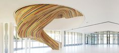 """""""Great stair for the School of Arts comprised of laminated timber. Some of the timber strips have been painted adding extra dynamics."""" (Designed by Tetrarc)"""