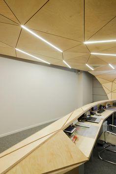 Plywood reception by Totan Kuzembaev Architectural Workshop as Architects