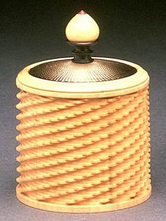 A Jon Sauer ornamental box, made of Boxwood, Gold, Blackwood & Pink Ivory Wood. jS