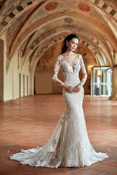 Elegance and romance embrace the beauty of this lace embroidered fit-n-flare gown. With a deep V-neck, long sleeves and illusion back, what more can you ask for in your wedding dress?