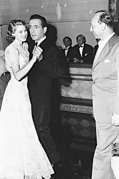 Humphrey Bogart & Ingrid Bergman dancing on the set of CASABLANCA (1942) with director Michael Curtiz.