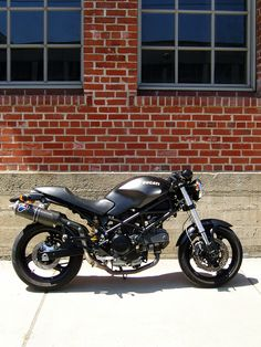 A Ducati Monster 695 Dark. It is off the road just now but it is mine and I still love it and I will be back out there this summer.
